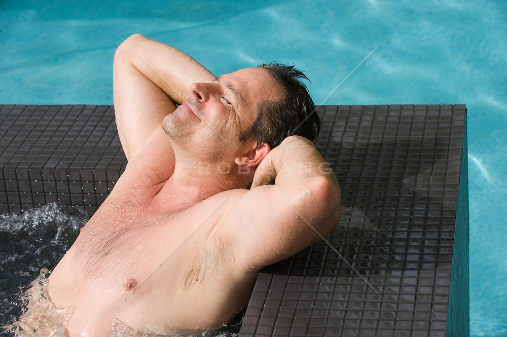 Good looking Man Enjoying Time In A Hot Tub