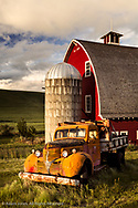 Red Barn, old truck, and wheat field at sunrise, near Colfax, Palouse region of eastern Washington.