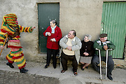 """Old Podence villagers receive one """"careto"""" with suspiction. """"Caretos"""" used to hurt women with their cowbell belts."""