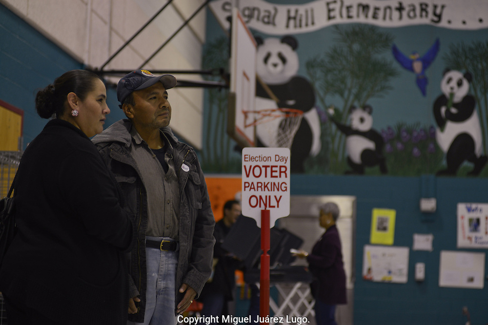 MANASSAS, VA - NOV 06, 2012.-  First time voters, Francisco and Maria Carmen Vargas, wait their turn to cast their vote in a polling station in Signal Hill elementary school on November 06, 2012. The Vargas migrated from Mexico and became US citizens in 2009.  The Latino community in the northern area of the swing state of Virginia could be a factor in this presidential elections (Photo by Miguel Juárez Lugo).