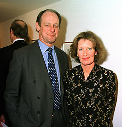 VISCOUNT & VISCOUNTESS TORRINGTON at an exhibition in London on 16th December 1999.MZY 16