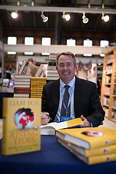 © Licensed to London News Pictures . 30/09/2013 . Manchester , UK . DR LIAM FOX , MP for North Somerset and former Defence Minister , at a book signing at the Conservative Party Conference this afternoon (Monday 30th September 2013) . Day 2 of the Conservative Party Conference 2013 at Manchester Central . Photo credit : Joel Goodman/LNP