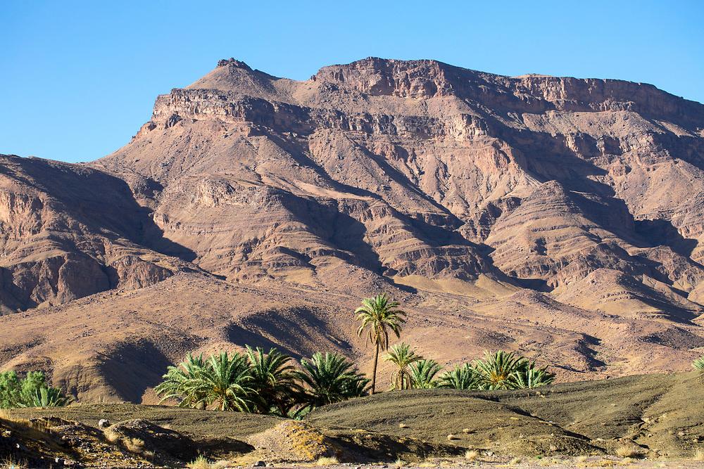 AGDZ, MOROCCO - 13th June 2015 - Landscape of distinctive windswept syncline rock formations Djebel / Jebel / Jbel (Mount) Kissane mountain, Draa Valley, Southern Morocco