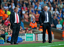 LIVERPOOL, ENGLAND - Saturday, April 23, 2011: Liverpool's manager Kenny Dalglish MBE and Birmingham City's manager Alex McLeish during the Premiership match at Anfield. (Photo by David Rawcliffe/Propaganda)