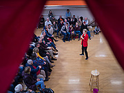 15 DECEMBER 2019 - WASHINGTON, IOWA: US Senator ELIZABETH WARREN (D-MA), seen through the bunting around the venue, speaks to a crowd of about 200 people during a campaign event at Washington Middle School Sunday. Warren is campaigning in southeastern Iowa this weekend to support her effort to be the Democratic nominee for the US presidential race in 2020. This was Warren's 182nd town hall, and 85th event in Iowa. Iowa traditionally hosts the first presidential selection event of the campaign season. The Iowa caucuses are Feb. 3, 2020.      PHOTO BY JACK KURTZ