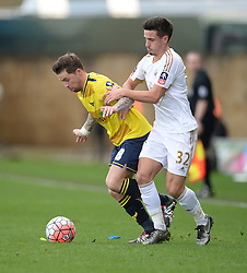 Chris Maguire of Oxford United battles for the ball with Liam Shephard of Swansea City - Mandatory byline: Alex James/JMP - 10/01/2016 - FOOTBALL - Kassam Stadium - Oxford, England - Oxford United v Swansea City - FA Cup Third Round