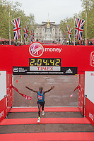 Eliud Kipchoge of Kenya crosses the finishing line on The mall to win The Virgin Money London Marathon in a time of 2:04:42, Sunday 26th April 2015.<br /> <br /> Dillon Bryden for Virgin Money London Marathon<br /> <br /> For more information please contact Penny Dain at pennyd@london-marathon.co.uk
