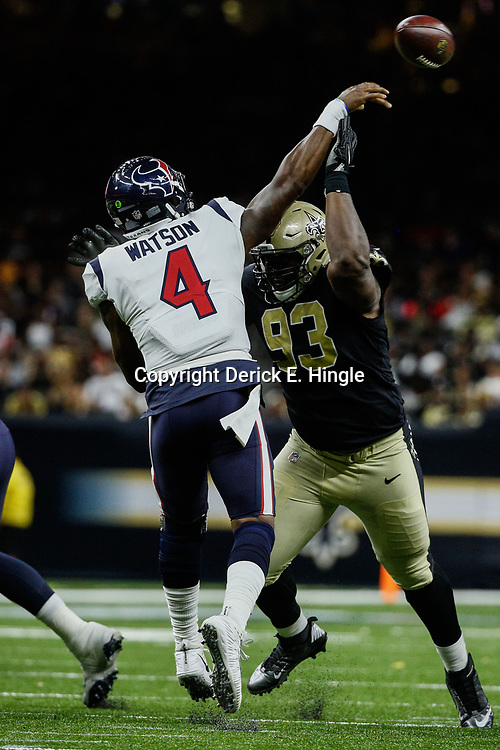 Aug 26, 2017; New Orleans, LA, USA; New Orleans Saints defensive tackle David Onyemata (93) pressures Houston Texans quarterback Deshaun Watson (4) during the second quarter of a preseason game at the Mercedes-Benz Superdome. Mandatory Credit: Derick E. Hingle-USA TODAY Sports