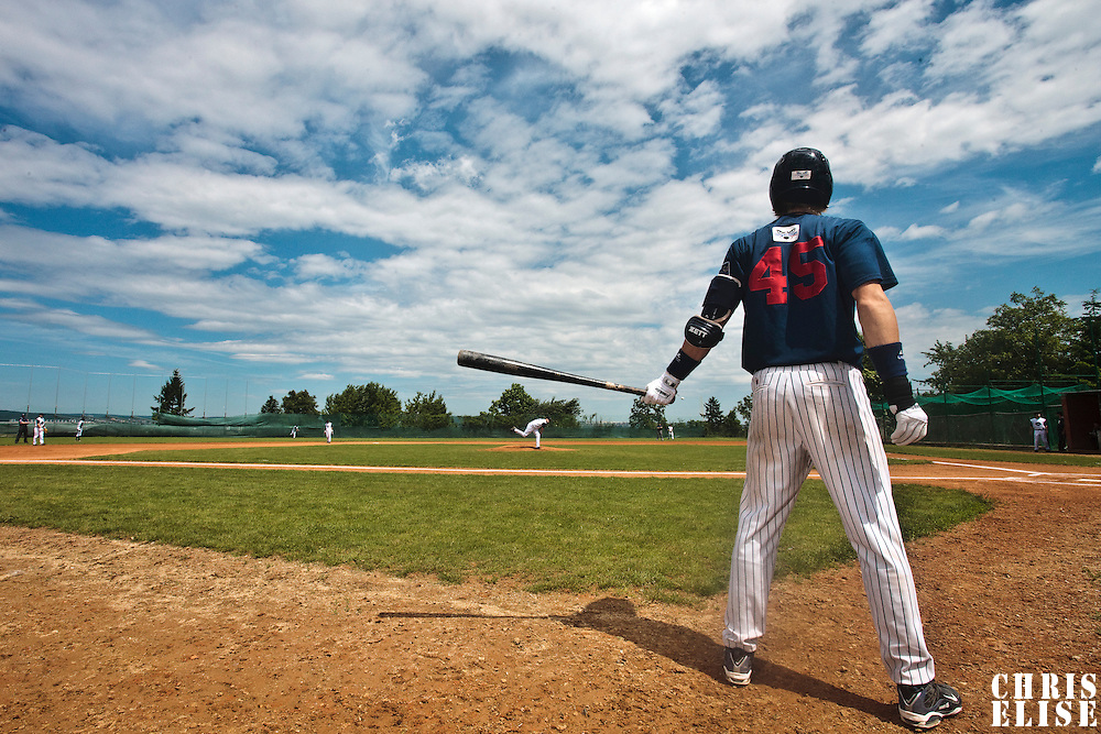 04 June 2010: Luc Piquet of Rouen warms up in the batter box during the 2010 Baseball European Cup match won 19-9 by Konica Minolta Pioniers over the Rouen Huskies, at the Kravi Hora ballpark, in Brno, Czech Republic.