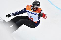 GABEL Keith USA competing in ParaSnowboard, Snowboard Banked Slalom at  the PyeongChang2018 Winter Paralympic Games, South Korea.
