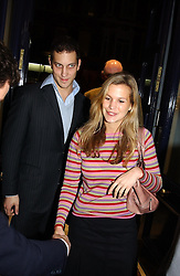 LORD FREDERICK WINDSOR and MISS CLEMENTINE BROWN at a party to celebrate the 21st year of Hackett held at their store in Sloane Street, London on 26th October 2004.<br />