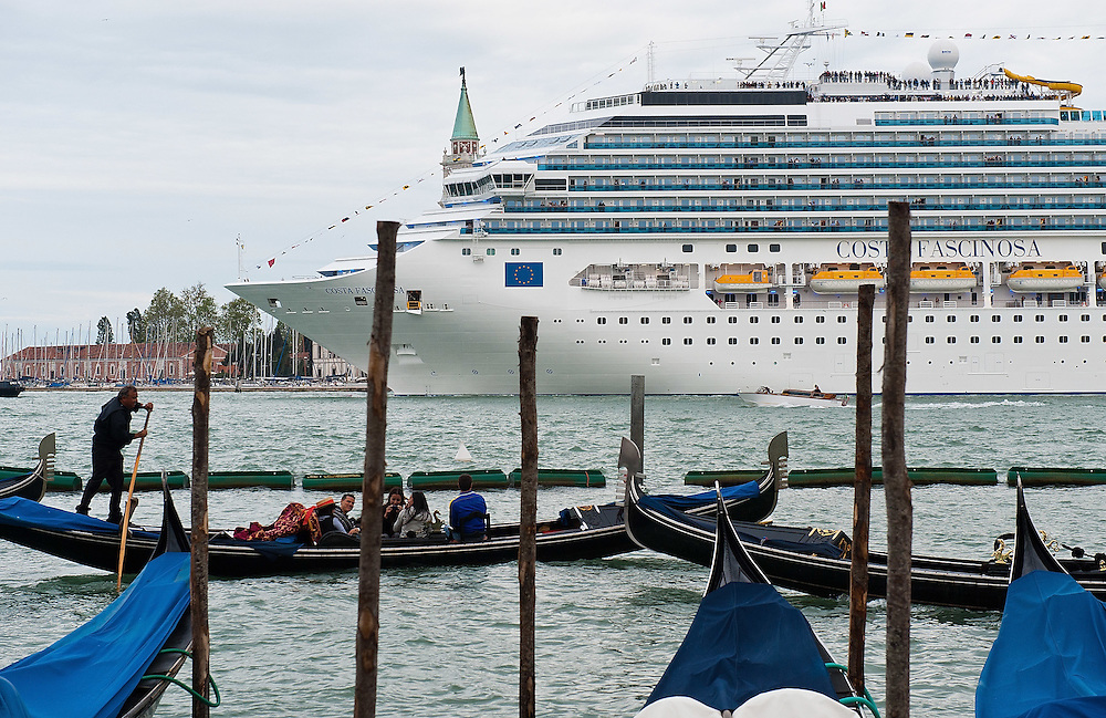 VENICE, ITALY - MAY 06:  The new flagship of Costa Cruises Fascinosa sails in St Mark's Basin in front of two gondolas on its madien voyage on May 6, 2012 in Venice, Italy. Costa Cruise announced yesterday that new safety systems are installed to avoid tragedies like the one island of Giglio, which saw the Costa Concordia sink with the loss of 34 lives.  (Photo by Marco Secchi/Getty Images)