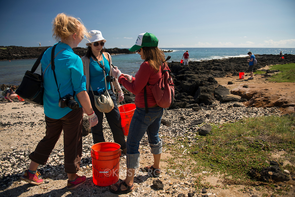 While in Hawaii, students from Professor Jeremiah Chamberlin's Writing and Academic Inquiry class participated in a field lab in which they visited the southern shores of the Big Island to collect marine debris. Marine debris typically comes from land-based sources such as storm runoff, but is also deposited via ocean-based sources such as fishing vessels. Catherine Spina shows a plastic oyster spacer used in aquaculture to Colleen Doohan from Oral Roberts University and Grecia De la O Abarca from Middleton College.