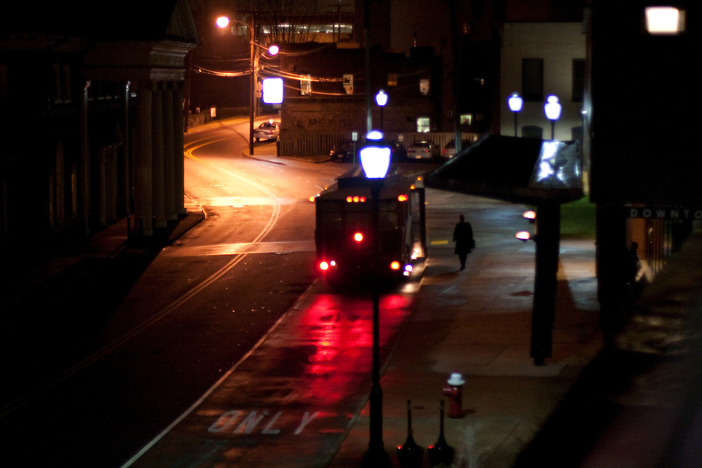 A passenger boards the free trolley in the evening, at the Downtown Transit Station, Charlottesville Virginia.
