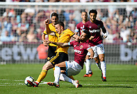 Football - 2018 / 2019 Premier League - West Ham United vs. Wolverhampton Wanderers<br /> <br /> Wolverhampton Wanderers' Diogo Jota is fouled by West Ham United's Ryan Fredericks leading to a yellow card, at The London Stadium.<br /> <br /> COLORSPORT/ASHLEY WESTERN