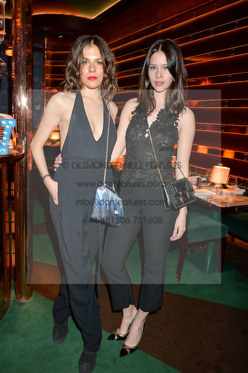 Left to right, MORGANE POLANSKI and JESSAMINE BLISS BELL at a dinner hosted by Roger Vivier to celebrate The Prismick Denim by Camillle Seydoux held at Casa Cruz, 123 Clarendon Road, London on 17th March 2016.
