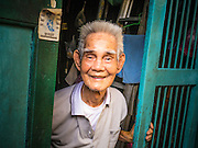 20 APRIL 2013 - BANGKOK, THAILAND:   A Teo Chew Chinese man in front of his home in Talat Noi (Talat means Market, Noi means Small. Literally Small Market). The Talat Noi neighborhood in Bangkok started as a blacksmith's quarter. As cars and buses replaced horse and buggy, the blacksmiths became mechanics and now the area is lined with car mechanics' shops. It is one the last neighborhoods in Bangkok that still has some original shophouses and pre World War II architecture. It is also home to a  Teo Chew Chinese emigrant community.   PHOTO BY JACK KURTZ