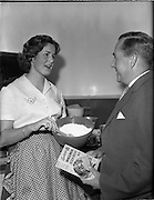 26/10/1959<br /> 10/26/1959<br /> 26 October 1959<br /> Swiss Charge d'Affairs visit to Goodbody's Factory, Dun Laoghaire, (Albright and Wilson Ireland).  Image shows the visitor being given a demonstration on mixing soda bread from Goodbody's Wholemeal Soda Bread Mix.