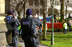 Police video & photographic surveillance of a small anti war in Iraq demo; Newcastle; during Labour Party spring conference Gateshead NE England 2005