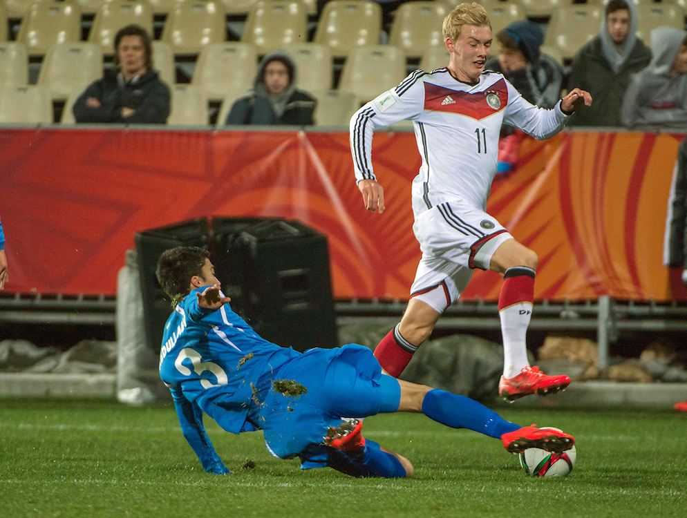 Ibrokhim Abdullaev, left, of Uzbekistan fails to stop Julian Brandt of Germany in the Under 20 soccer World Cup match, Christchurch, New Zealand, Thursday, June 04, 2015. Credit:SNPA / David Alexander