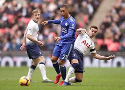 Tottenham Hotspur's Juan Foyth (centre) and Tottenham Hotspur's Harry Winks (right) battle for the ball