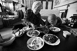 Chinese disabled artist Xi Fu (R ) and his mother Dong Xifeng have lunch in their home in Daxing on the outskirts of Beijing, China 18 June 2013. The calligraphy street artist lives with his retired parents but does everything for himself with his feet, including personal chores and eating. Xi Fu's story is one that tells of how strong determination and hard work overcame the difficulties of surviving in a society scant with infrastructure and support for the disabled and where they are often discriminated and sidelined.
