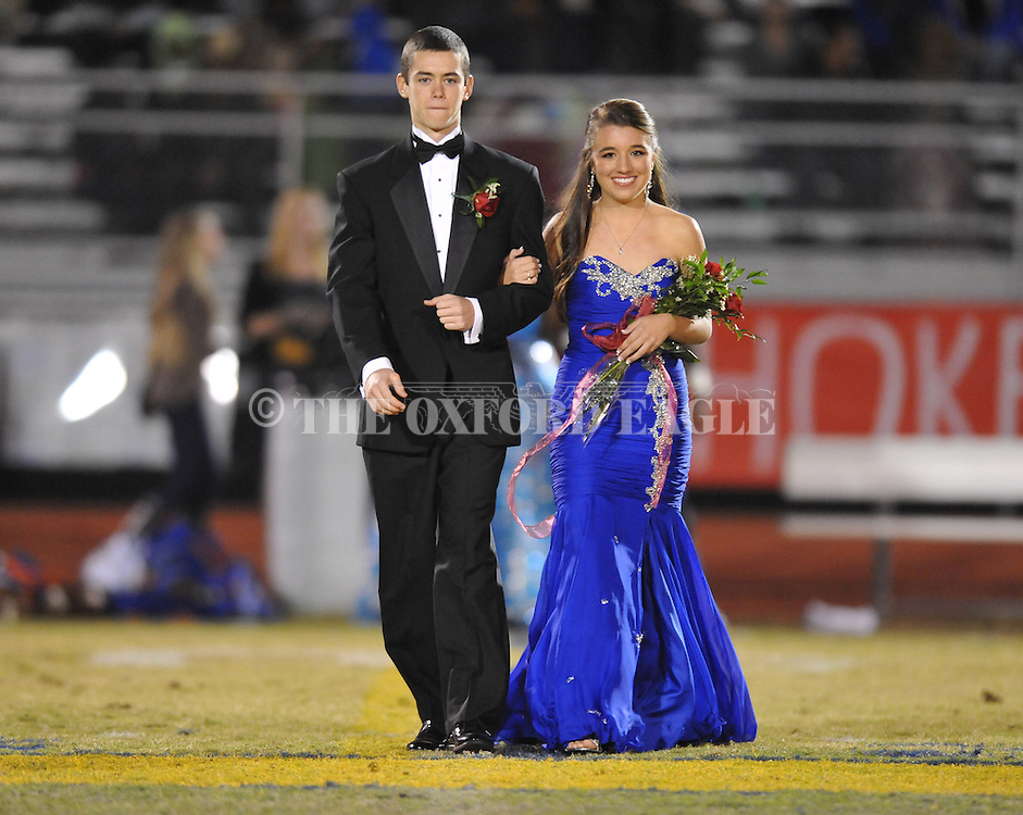 Josh Gibbs (left) escorts sophomore maid Abby Collier during Homecoming ceremonies vs. Saltillo in Oxford, Miss. on Friday, October 19, 2012. Oxford won to improve to 9-0.