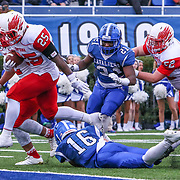 Smyrna Eagles running back WILLIAM KNIGHT (25) jumps over Middletown's Nicholas Johnston (16) for a touchdown in the fourth quarter of the 2017 DIAA Division I state championship game between the Smyrna Eagles and Middletown Cavaliers Saturday, Dec. 02, 2017 at Delaware Stadium in Newark, DE.