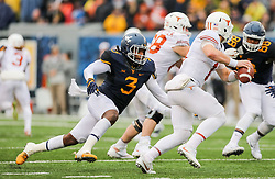 Nov 18, 2017; Morgantown, WV, USA; West Virginia Mountaineers linebacker Al-Rasheed Benton (3) rushes Texas Longhorns quarterback Sam Ehlinger (11) during the third quarter at Milan Puskar Stadium. Mandatory Credit: Ben Queen-USA TODAY Sports