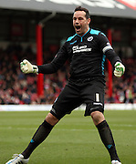 David Forde celebrating Millwall scoring during the Sky Bet Championship match between Brentford and Millwall at Griffin Park, London, England on 21 March 2015. Photo by Matthew Redman.