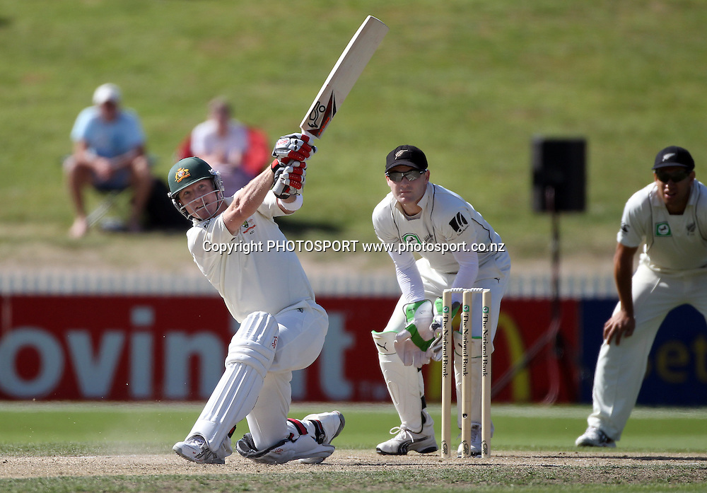 Brad Haddin hits a 6 as Brendon McCullum looks on.<br />