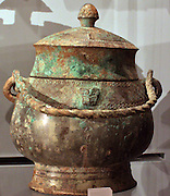 Bronze ritual wine vessel, you, Shang dynasty.  Anyang period, about 1200-1050 BC.