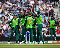 Cricket - 2019 ICC Cricket World Cup - Group Stage: England vs. South Africa<br /> <br /> South Africa celebrate taking the wicket of England's Joe Root caught by JP Duminy off the bowling of Kagiso Rabada for 51, at The Kia Oval.<br /> <br /> COLORSPORT/ASHLEY WESTERN