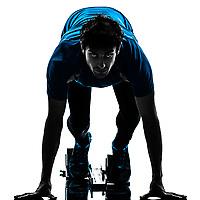 one  man runner sprinter on starting blocks in silhouette studio isolated on white background