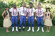KO OLINA - FEBRUARY 11:  NFC Carolina Panthers 2005 NFL Pro Bowl All-Stars (players left to right: Mark Fields #58, Julius Peppers #90, Mushin Muhammad #87, Dan Morgan #55) pose with Hawaiian Hula girls for their 2005 NFL Pro Bowl team photo on February 11, 2005 in Ko Olina, Hawaii. ©Paul Anthony Spinelli
