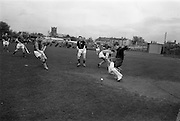 11/04/1964<br /> 04/11/1964<br /> 11 April 1964<br /> Irish Senior Hockey Cup Final, Three Rock Rovers v Church of Ireland (Cork) at Londonbridge Road, Dublin.  Church of Ireland Keeper Noel Johnston clears the ball from his goalmouth.