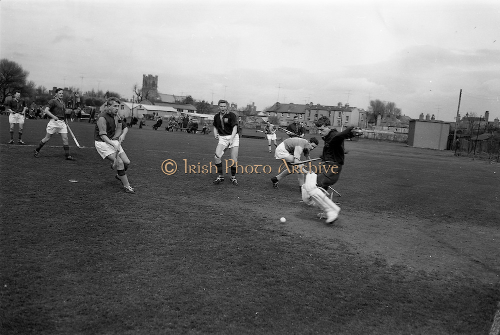 11/04/1964<br /> 04/11/1964<br /> 11 April 1964<br /> Irish Senior Hockey Cup Final, Three Rock Rovers v Church of Ireland (Cork) at Londonbridge Road, Dublin.  Church of Ireland Keeper Noel Johnston clears the ball from his goalmouth.