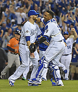 Oct 9, 2015; Kansas City, MO, USA; Kansas City Royals pitcher Wade Davis (17) celebrates with catcher Salvador Perez (13) after beating the Houston Astros in game five of the ALDS at Kauffman Stadium. Mandatory Credit: Peter G. Aiken-USA TODAY Sports