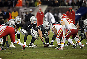 Oakland Raiders center Stefen Wisniewski (61) gets set to snap the ball at the line of scrimmage during the NFL week 12 regular season football game against the Kansas City Chiefs on Thursday, Nov. 20, 2014 in Oakland, Calif. The Raiders won their first game of the season 24-20. ©Paul Anthony Spinelli
