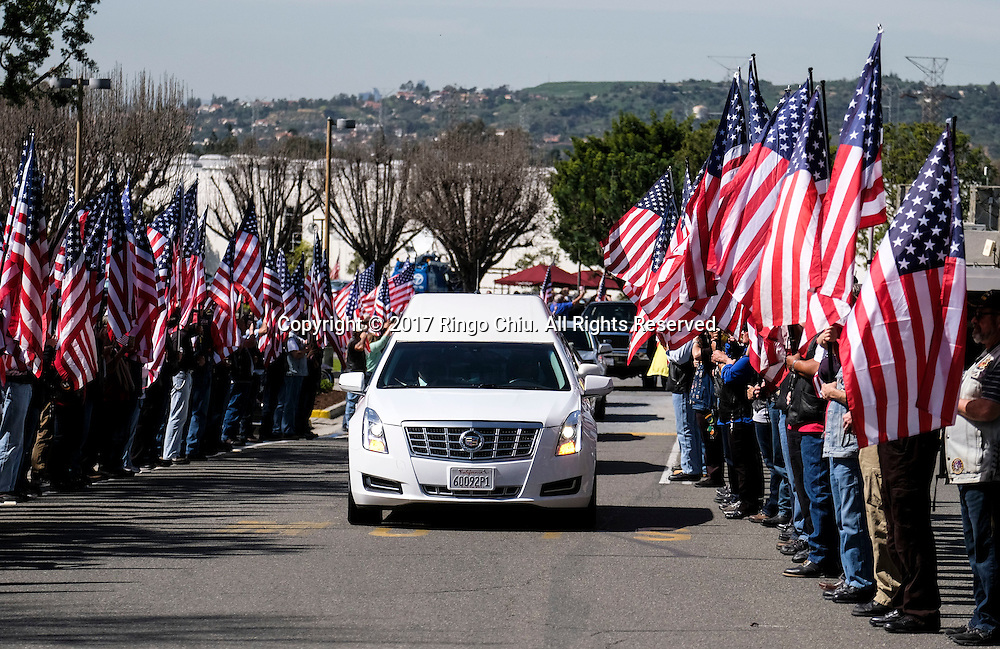 The hearse carrying the body of Whittier Police Officer Keith Boyer arrives at Rose Hills Memorial Park in Whittier, Calif., Friday March 3, 2017. Boyer, who was fatally shot after responding to a traffic crash, was remembered today by thousands of law enforcement officers, friends and family as a dedicated public servant, talented drummer, loving friend and even a ``goofy'' dad.(Photo by Ringo Chiu/PHOTOFORMULA.com)<br /> <br /> Usage Notes: This content is intended for editorial use only. For other uses, additional clearances may be required.