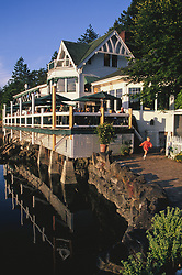 North America, United States, Washington, San Juan Islands, child running near restaurant at Rosario marina