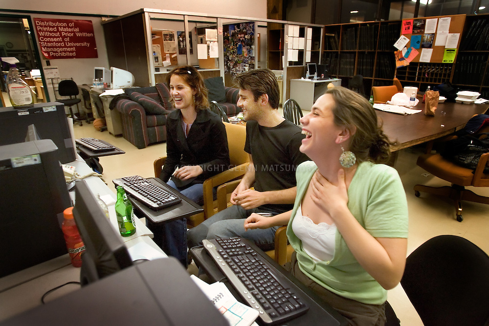 Stanford after dark. Stanford Daily editors work on late night editing. Student newspaper.