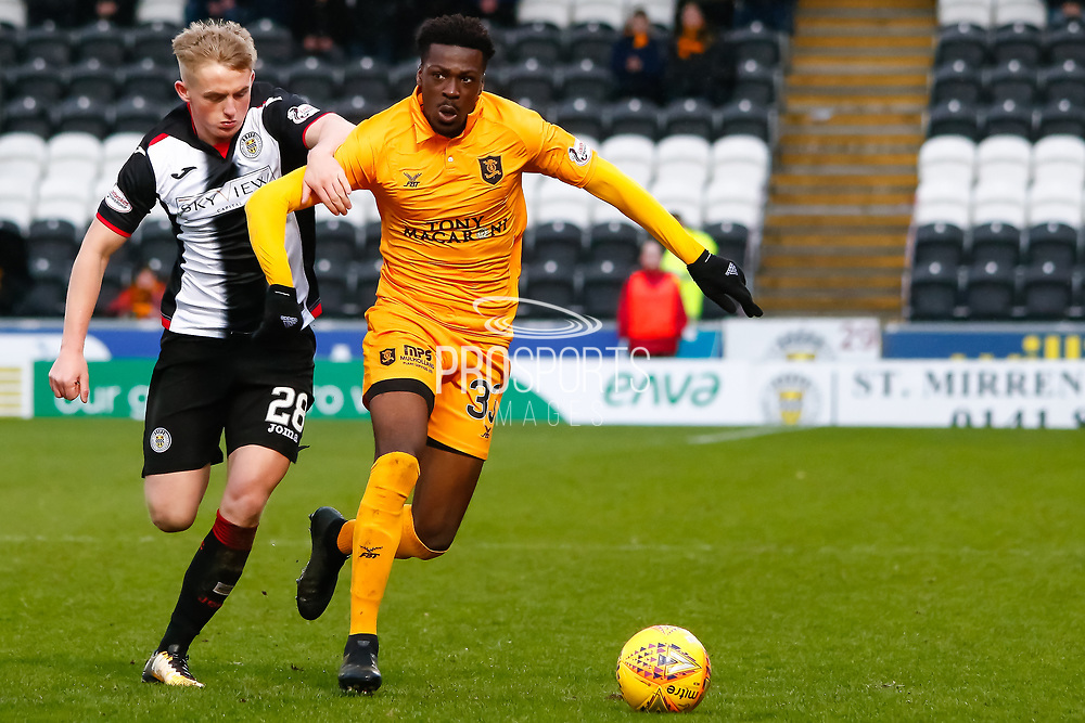 Steve Lawson of Livingston & Cameron MacPherson of St Mirren chase the loose ball during the Ladbrokes Scottish Premiership match between St Mirren and Livingston at the Simple Digital Arena, Paisley, Scotland on 2nd March 2019.