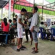 Kachin State. Rehab guests serve at a 								 wedding party, but are banned from 								 contact with other people. Officer rebukes 								 young rehab guest for being too nice with 								 a girl.