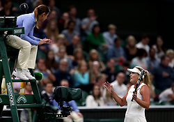 Coco Vandeweghe speaks to the umpire during her match against Magdalena Rybarikova on day eight of the Wimbledon Championships at The All England Lawn Tennis and Croquet Club, Wimbledon.