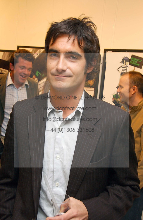 VISCOUNT CASTLEREAGH at an exhibition of photographs entitled 'Protect The Human' by photographers Jake Gavin and Sean Gleason commissioned by Amnesty Internationlal and held at The Hospital, 24 Endell Street, London WC2 on 31st May 2006.<br />
