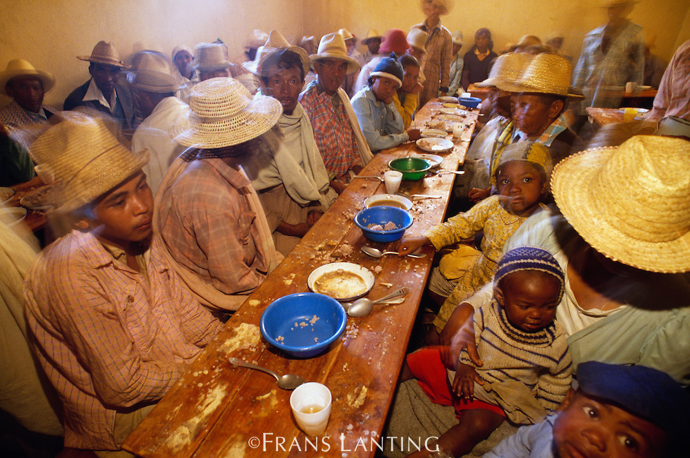 Funeral guests sharing a meal near Tananarive, Madagascar
