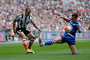 FC Halifax Town defender James Bolton makes a tackle during the FA Trophy match between Grimsby Town FC and Halifax Town at Wembley Stadium, London, England on 22 May 2016. Photo by Dennis Goodwin.