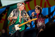 HAVANA, CUBA - MARCH 25, 2016: Keith Richards and Mick Jagger perform with The Rolling Stones at Ciudad Deportiva on March 25, 2016 in Havana, Cuba. The Rolling Stones performance is the first by a major international rock band in Cuba, coming days after a historic visit by President Barack Obama of the United States, and a game between the Tampa Bay Rays and the Cuban National Team at Estadio Latinoamericano. The Cuban government banned rock music on Cuban state TV and radio following the Cuban the revolution, and nearly a half-million people are in attendance to be part of the historic event. (Photo by Jean Fruth)