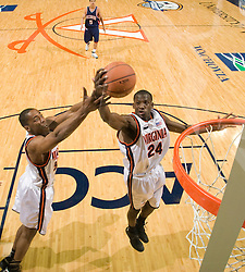 Virginia guard/forward Mamadi Diane (24) and forward/center Jerome Meyinsse (55) grab a rebound against Richmond.  The Virginia Cavaliers men's basketball team defeated the Richmond Spiders 66-64 in the first round of the College Basketball Invitational (CBI) tournament held at the University of Virginia's John Paul Jones Arena in Charlottesville, VA on March 18, 2008.